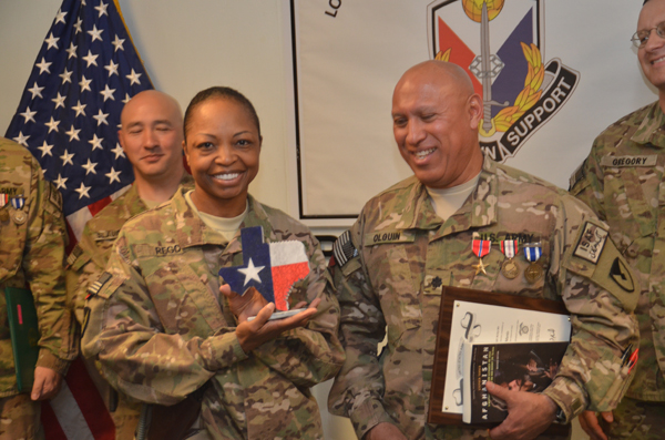 COL Anna A Laurie Rego is presenting LTC Heber Olguin with his 2nd Bronze Star, The Distinguished Order of Saint Martin and other momentos of appreciation for his outstanding service and performanc