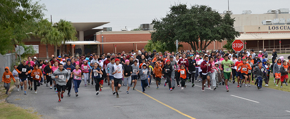 Participants burst from the starting point at last year's Leo Aguilar Foundation 5K Walk/Run last year. Photo:LFCISD