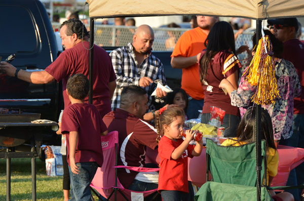 Los Fresnos Falcons fans barbecueing while school students perform at last year's Tailgate Zone. Photo: LFCISD