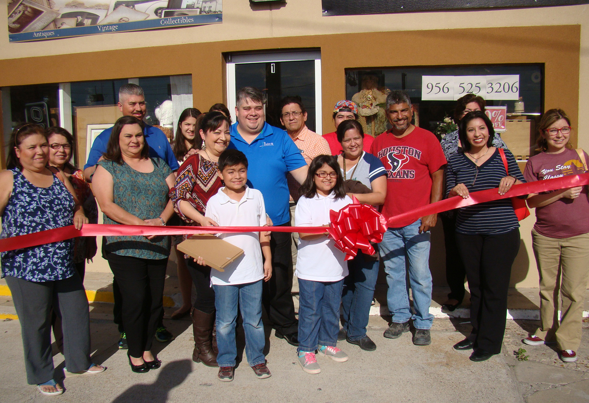 Friends, family and community leaders celebrate the opening of two new businesses in Los Fresnos, TX. Photo: Special to LFN
