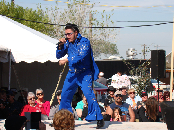 Luis Salazar from Laredo Texas entertains gathered faithful Elvis Presley fans with his energetic tribute to the King of Rock n' Roll during the 2015 Little Graceland festival. Photo: Victor Moreno/LFN Archive