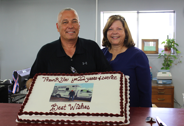 Gene and Chrissy Daniels display the cake presented to Gene with thanks for 22 years of service.