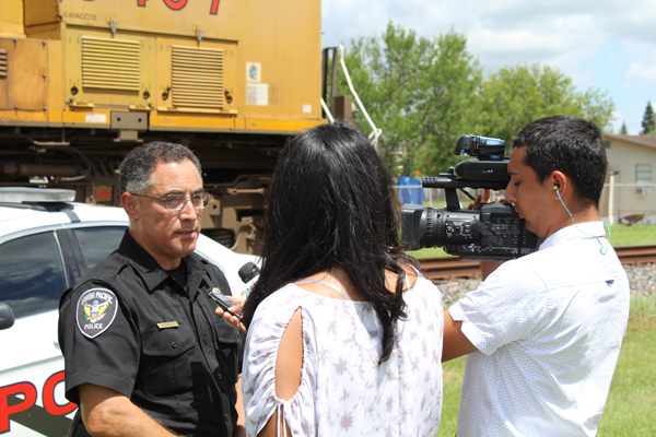 Union Pacific Police Sr. Special Agent Rodriguez addresses television media on the railroad's safety outreach and public safety campaigns.