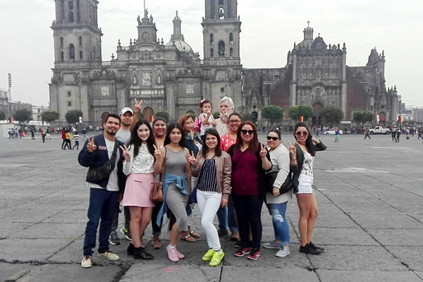 UTRGV students attending a summer study abroad communications class in Mexico City pause for a photo in front of the Basílica de Nuestra Señora de Guadalupe in the Zócalo, the city's main square. The group includes (from left) Esai Torres, Luis Cavazos, Daliarlene Saenz, Vanessa Soto, Ninah Caquias, Lupita Strong, Adriana Gutierrez, Bianca Lopez, Osmara Garcia, Sarah Peña and Yvette Salinas. In the back row is Dr. William Strong, UTRGV communications professor who conducted the class, holding his daughter, Scarlett. Courtesy Photo