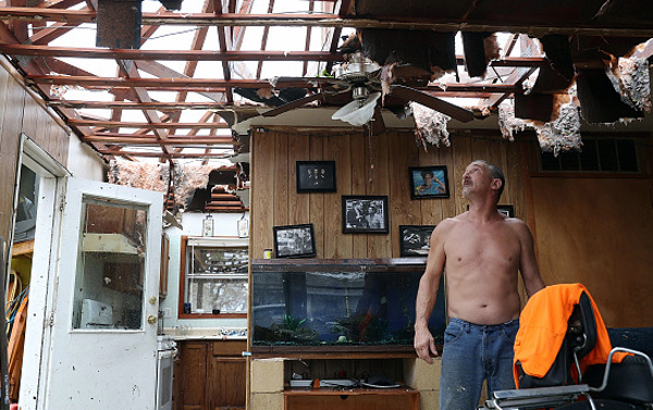 Aaron Tobias inspects what is left of his Rockport home after Hurricane Harvey made landfall Saturday as a Category 4 storm with 130-mph winds. Photo: JoeRaedle/GettyImages