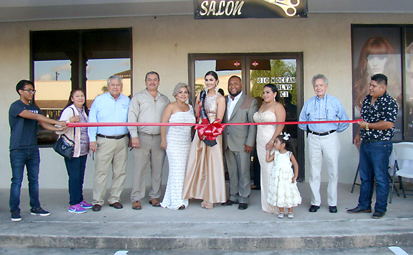 The Urbina and Juarez family celebrate the new location for New Look Salon at 810 W. Ocean Boulevard, Suite C-1 with a ribbon cutting. Photos: Victor Moreno/LFN