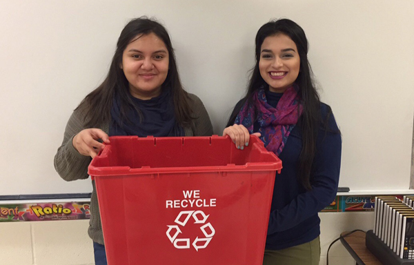 "L-R Norma Perales and Karen Lamas (not pictured is Mariah Gutierrez) are Senior members of DECA endorsing new initiatives on recycling through their project called ""The New Green"". Photo: Karen Lamas"