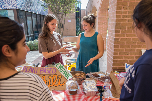 Suzanne El-Haj (at left) and Martha Garcia, co-presidents of the UTRGV Environmental Awareness Club, spearhead the monthly UTRGV Farmers Market, open to students and the public alike and held outside the Recreation Center on the Edinburg Campus. All produce sold at the farmer's market is certified organic, and the focus is on promoting healthier eating habits.  Photo: Paul Chouy/UTRGV
