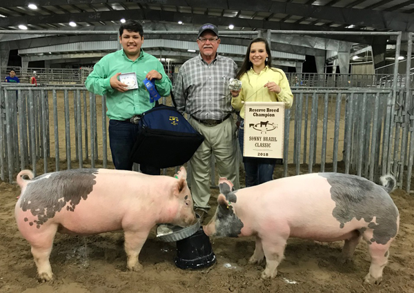 Corbin Cruz, a Los Fresnos High School senior took home Grand Champion of Show and Caitlynn Cruz, a sophomore at Los Fresnos United won Reserve Grand Champion of Show and Champion Showman of Show, both in the market hog division. Eddie Cruz, 4H Club Leader/Manager