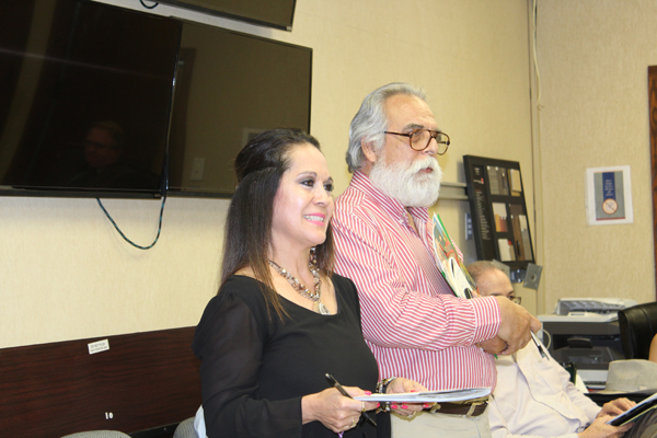 Rogelio Nuñez, right, director of the Narciso Martinez Cultural Arts Center, and Blanca Davis, addressing  Los Fresnos  Community Development Corp. board.