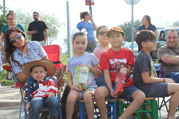 The Delgado and Pena families enjoying the parade. Photo: Tony Vindell/LFN