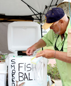 Fish ball chef Terry Larson gets ready to give samples to people stopping by. Photo: Tony Vindell/LFN
