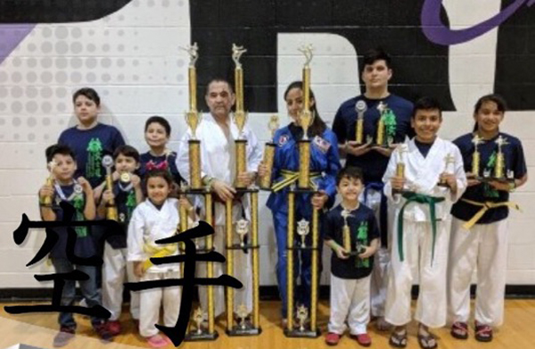 Academy instructor and students after the Weslaco tourney displaying the trophies. Courtesy photo.