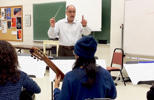 University of Texas Rio Grande Valley music professor Dr. Michael Quartz is shown here leading a guitar ensemble class at the UTRGV Brownsville Campus. The National Association for Music Education has selected him to lead the inaugural All-National Guitar Ensemble this year in November in Orlando, Florida.  Photo: Maria Elena Hernandez/UTRGV