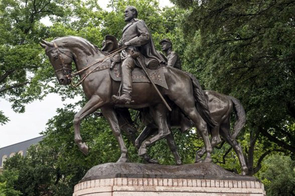This statue of Confederate Gen. Robert E. Lee in a Dallas park is part of the state's history. But a new report claims there are numerous errors in the history books used in Texas public schools. Photo: Wikimedia Commons