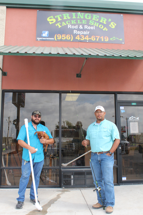 Fidencio Reyes, left, and William Brock, stand outside the store they opened this past January. Photo: Tony Vindell/LFN