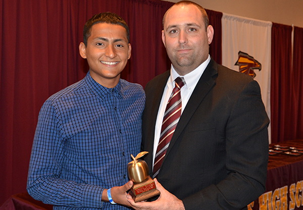 LFHS principal Justin Stumbaugh presents Apple Award recipient Manny Ortega