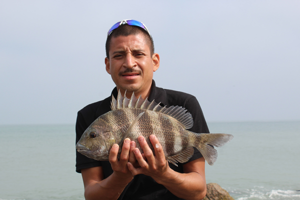 Daniel Leal of Brownsville shows his prized catch.