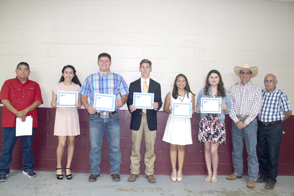 From left to right Noel Lopez with rodeo committee, and students Alyzza Nicole Garcia, Ty Garrett Rhyner, Hunter G. Lamon,  Aubree K. Ramos, Madison Taylor Wilson and rodeo committee members Larry Cantu and George Gomez. Not pictured are Rebecca Marie Jonhson and Margaret Elise Adair.