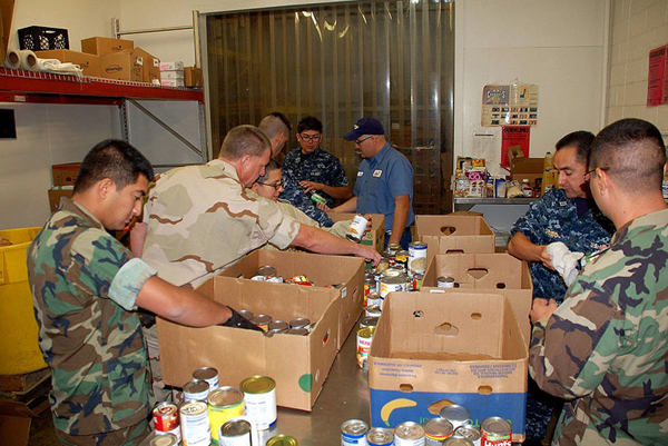 Military and civilian volunteers help sort and distribute food at the West Texas Food Bank in El Paso, one of 21 regional food banks across the state. Photo: WikimediaCommons