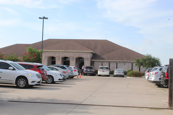 Scores of vehicles could be seen at an office off Highway 100, where people applied for jobs last week. Photo: Tony Vindell/LFN