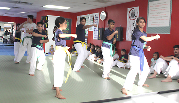Youngsters practicing karate at the academy in Los Fresnos