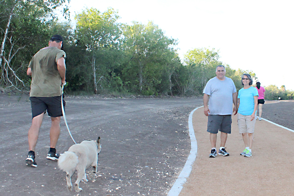 Orlando and Edna Medina, as well as others, are already taking advantage of the park under construction in Los Fresnos.  Photo: Tony Vindell/LFN