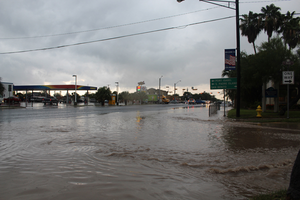 Water flowing from Third Street to North Arroyo Boulevard.