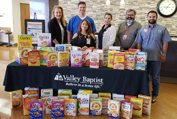 Employeess at one of VBHS hospitals with some of the thousands of cereal boxes donated during the eight-day drive. Courtesy photo.